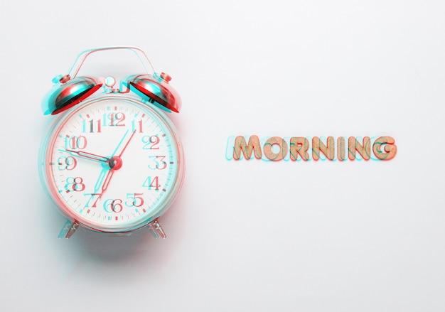 Despertador retrô cinza com texto manhã com letras