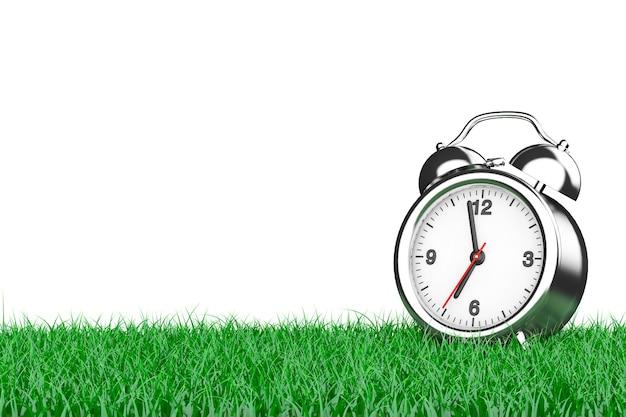 Despertador sobre a grama em um fundo branco. renderização 3d