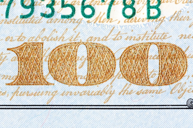 Detalhe da nota de cem dólares dos eua recentemente projetada. foto de alta resolução.
