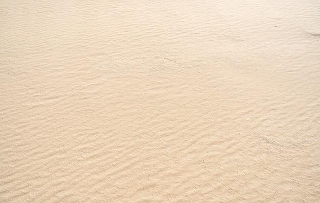 Detalhe de alta qualidade do fundo da textura da areia vista superior. bela natureza e fundo de viagens.