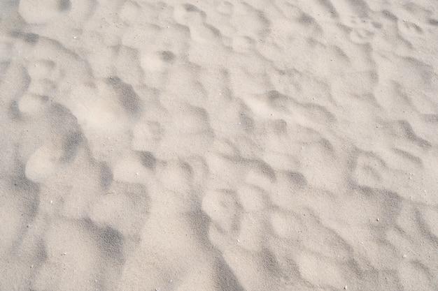 Detalhe de textura de areia em ilha tropical fundo de verão e design de viagem detalhe de alta qualidade da textura de areia de curva.