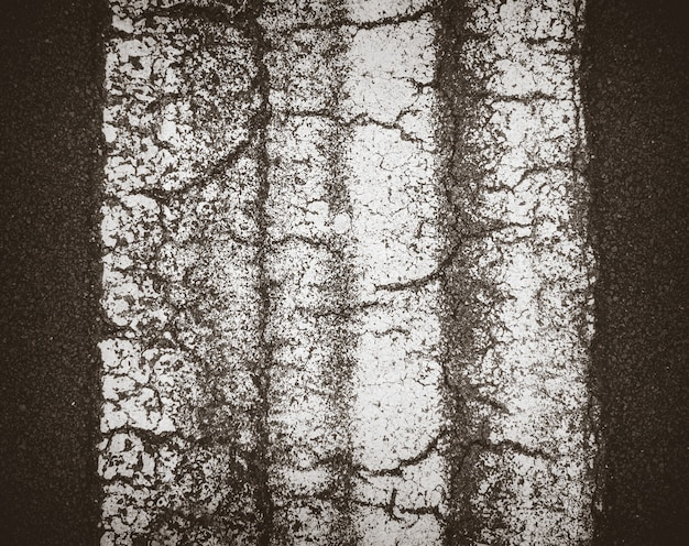 Detalhe de textura de asfalto preto com linha branca