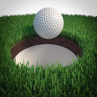 Detalhe de uma bola de golfe caindo no buraco.