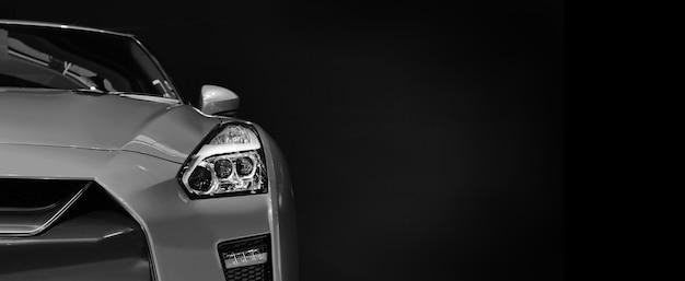 Detalhe em um dos faróis de led do carro moderno na parede preta, espaço livre no lado direito para texto.