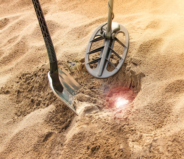 Detector de metais e tesouros brilhantes