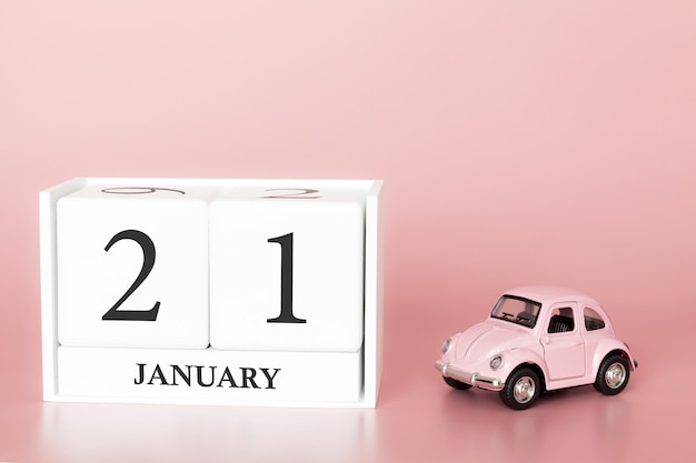 Dia 21 do mês de janeiro, calendário em um fundo cor-de-rosa com carro retro.