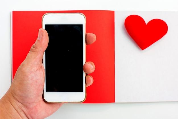 Dia dos namorados e dia mais doce, conceito de amor com caderno vermelho e espaço de cópia