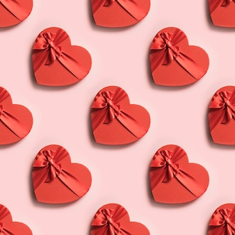 Dia dos namorados sem costura padrão de caixas de coração vermelho em rosa
