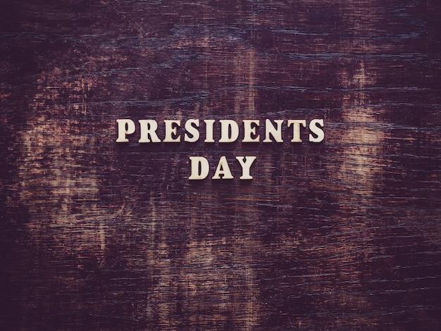 Dia dos presidentes na superfície de madeira