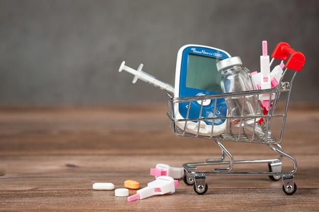 Dia mundial da diabetes; equipamento médico em piso de madeira