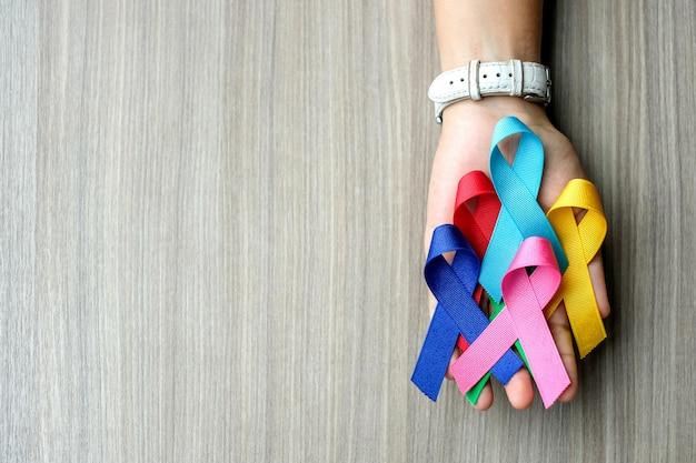 Dia mundial do câncer (4 de fevereiro). fitas coloridas da consciência