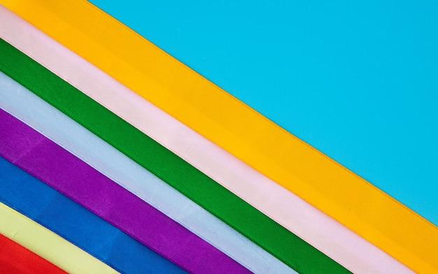 Dia mundial do câncer, 4 de fevereiro. fitas multicoloridas, símbolos da doença. conceito médico.