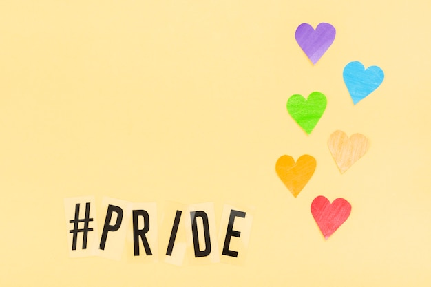 Dia mundial do orgulho feliz recorte corações de papel