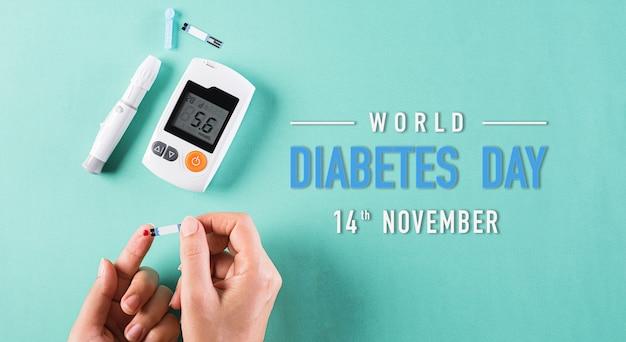 Diabético mede o nível de glicose no sangue. plano de fundo do dia de diabetes.
