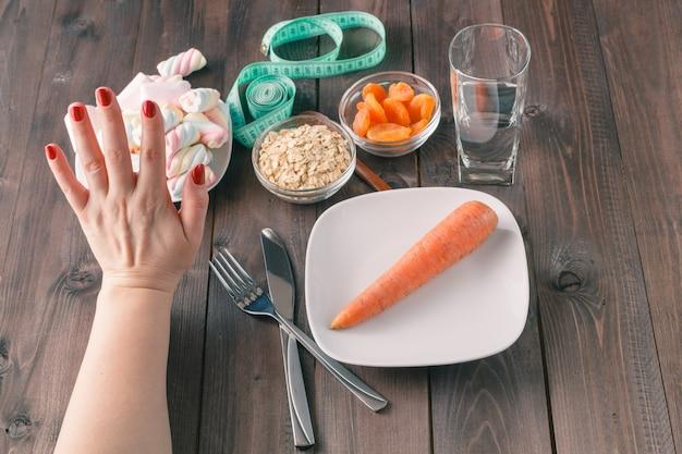 Dieta escolha doces ou cenoura