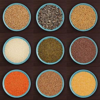 Diferentes tipos de sêmolas em um prato em um fundo marrom vários cereais de sêmolas