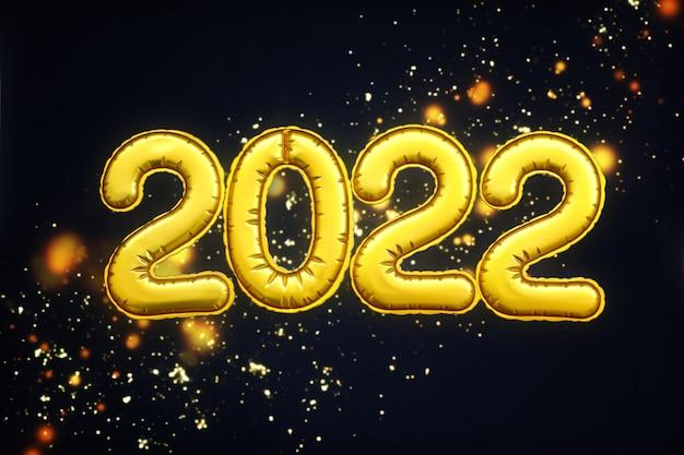 Dígitos de ouro 2.022 números do feliz ano novo mentem sobre um fundo preto. conceito de postura plana, decoração de festa natalícia ou cartão postal.