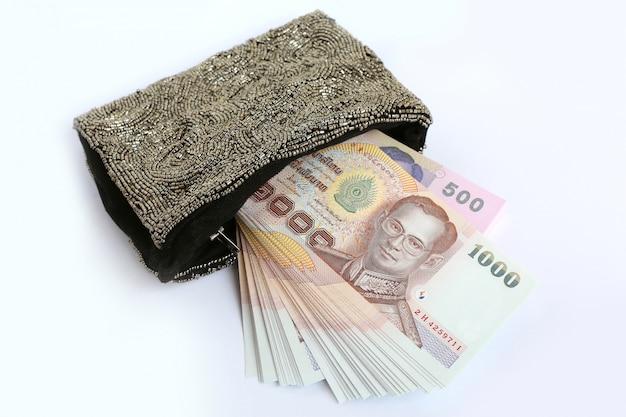 Dinheiro tailandês no saco
