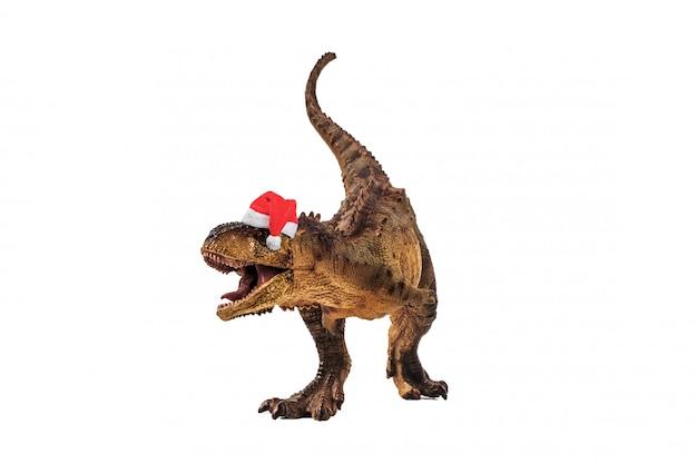 Dinossauro carnotaurus com chapéu de natal em branco