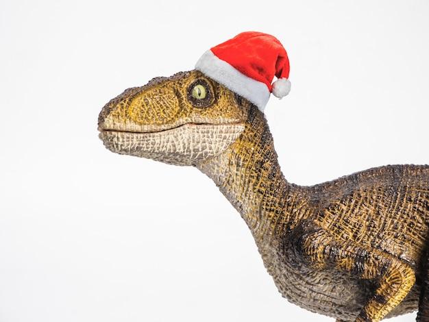 Dinossauro velociraptor com chapéu de natal