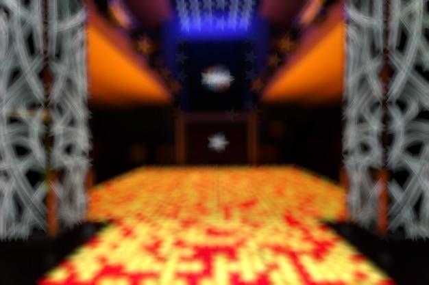 Disco entrada desfocado com quadrados amarelos e vermelhos