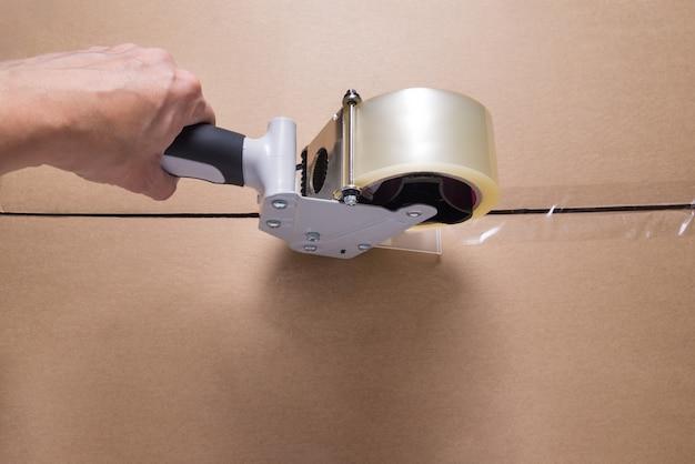 Dispensador de fita para embalagem