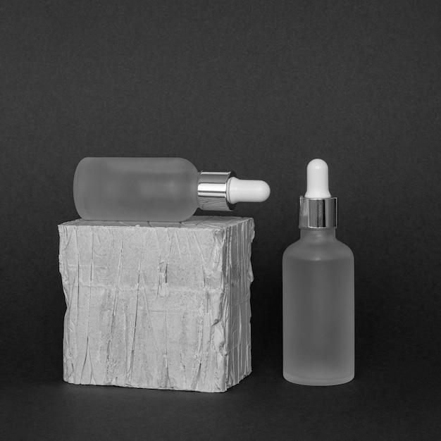 Disposição de conta-gotas de produto de pele de vista frontal