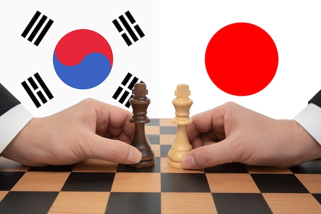 Disputa comercial coreia do sul-japão expressa em um jogo de xadrez.