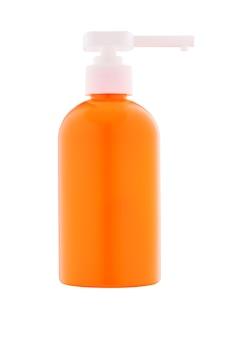 Distribuidor de plástico laranja para sabão ou espumas com proteção uv isolada em fundo branco.