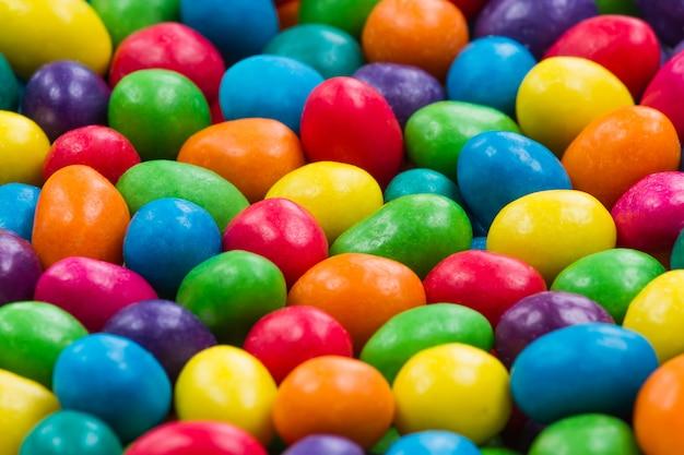 Doce cor doce. close-up de doces coloridos. fundo de doces