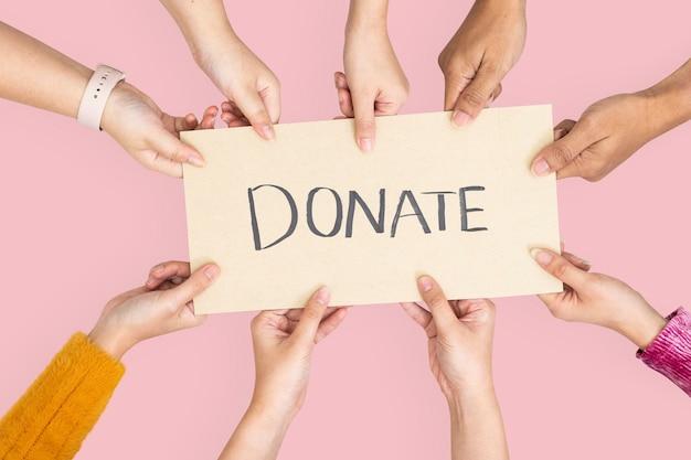 Doe sinal para campanha de caridade