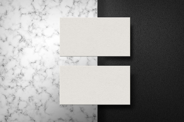 Dois cartões de visita na superfície de mármore