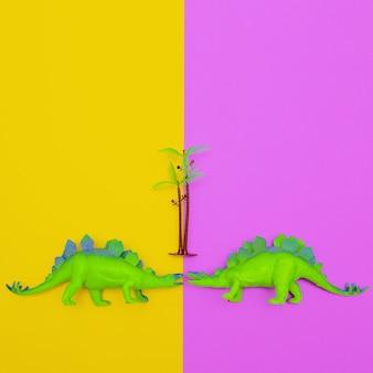 Dois dinossauros de plástico em fundo colorido. arte plana mínima.