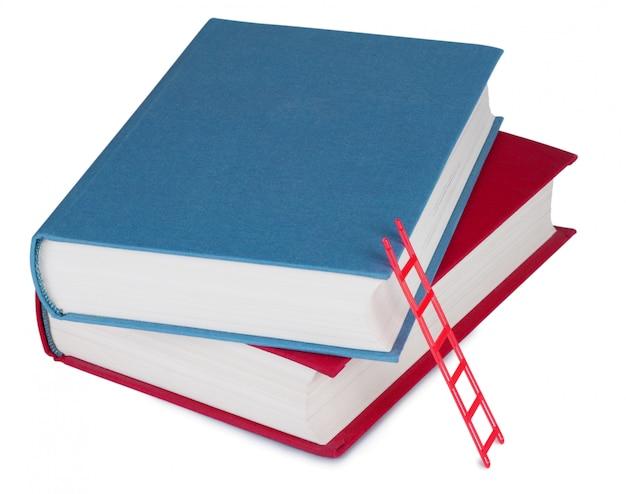 Dois livros com a escada vermelha