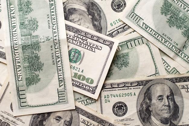 Dólares americanos da textura. fundo de cem notas de dólar.