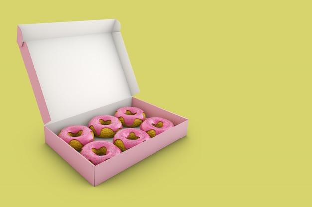 Donuts com glacê rosa na caixa.