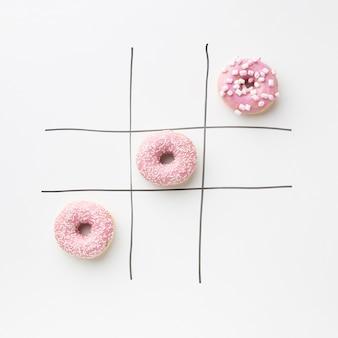 Donuts com tic tac toe conceito