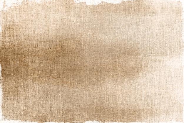 Dourado pintado em um plano de fundo de tecido texturizado
