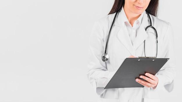 Doutor, mulher segura, área de transferência