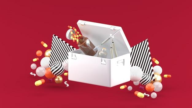 Drogas e seringas flutuando de um bolso de drogas entre bolas coloridas no vermelho. renderização em 3d.