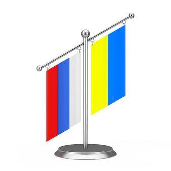 Duas bandeiras de mesa de tela da ucrânia e da rússia no pedestal de pináculo de aço em um fundo branco. renderização 3d
