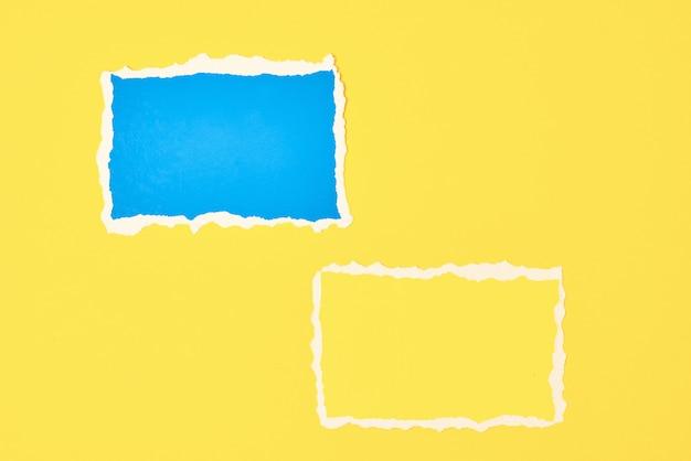 Duas folhas de papel rasgado com borda rasgada em amarelo