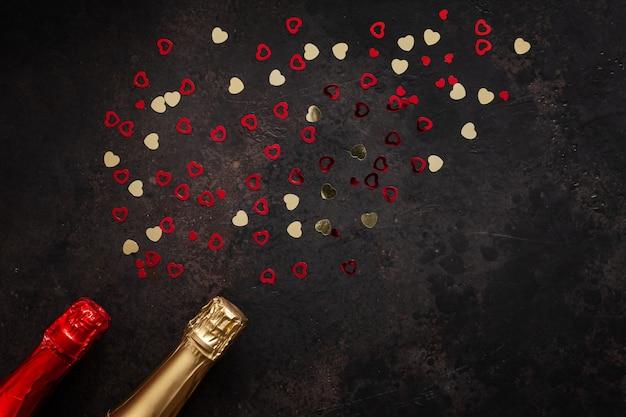 Duas garrafas de champanhe e padrão