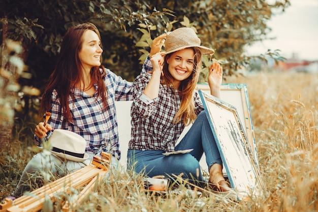 Duas lindas meninas desenho em um campo