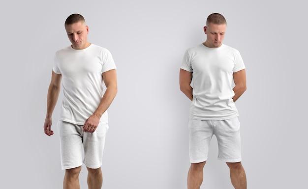 Duas maquetes para roupas de apresentação de projeto. modelo masculino atlético em uma camiseta em branco e shorts isolados em um fundo. vista frontal.