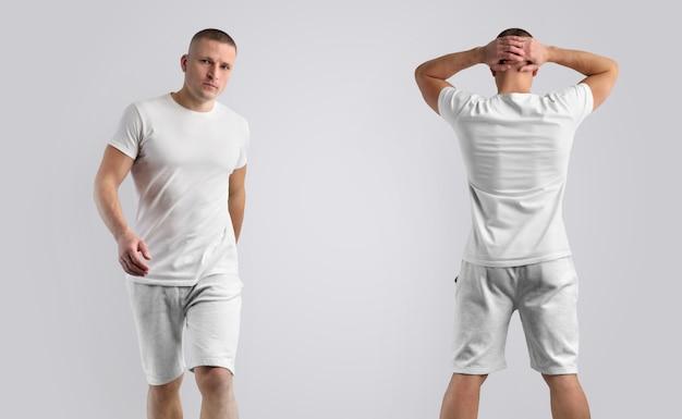 Duas maquetes para roupas de apresentação de projeto. modelo masculino magro em uma camiseta em branco e shorts cinza de malha isolados em um fundo.