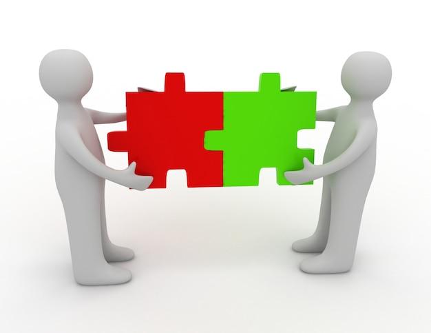 Duas pessoas combinando peças do quebra-cabeça