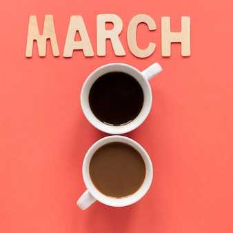 Duas xícaras de café em forma de data para o dia da mulher