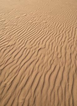 Dunas textura de areia na costa dorada