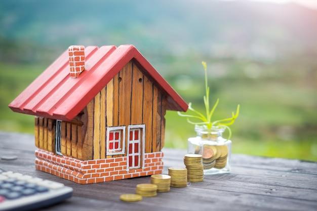 Economize dinheiro para comprar uma casa, com o objetivo de gastar dinheiro